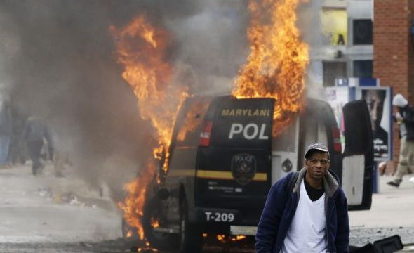 police car on fire looting fire riot baltimore